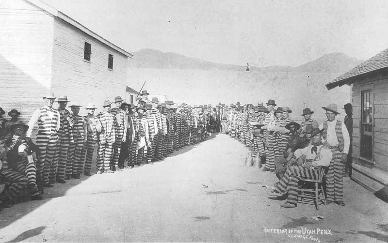[p.101] 112. Prisoners at the Utah Territorial Penitentiary in Sugar House pose in the courtyard in the 1880s. Savage visited the prison several times, photographing prominent Mormons incarcerated for plural marriage.