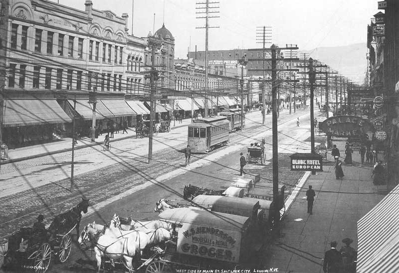 [p.111] 122. Modern street cars run down the center of Main Street, which is now lined with power and telephone poles.