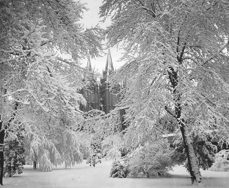[p.12] 17. A mantle of snow covers the Salt Lake Mormon Temple in the 1890s. The photo was taken by C. R. Savage not long after the temple was dedicated and after its grounds were landscaped and planted in trees.