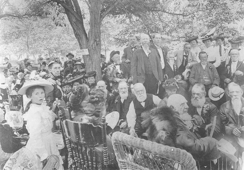 [p.121] 131. Savage, seated center to the right of the tree, is surrounded by senior citizens at the annual Old Folks' Day at Lagoon Amusement Park. Savage founded the popular annual event.