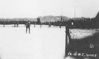 """""""The camp was such that they allowed you a certain freedom inside restricted compounds."""" Prisoners play a hockey game at Luft Stalag 3 where C. Grant Ash was held until a forced march began in January 1945."""