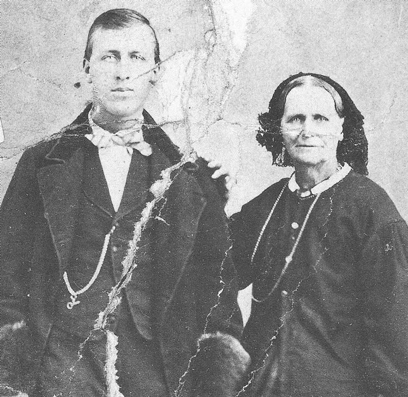 154. A worn albumen print in a family album shows how C. W. Symons and his mother looked when they left England in 1864.