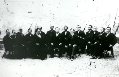 The earliest known photograph of the First Presidency and Quorum of the Twelve Apostles (ca. 1868). They are, front row, left to right: George A. Smith, Brigham Young, and Daniel H. Wells; back row, left to right: Orson Hyde, Orson Pratt, John Taylor, Wilford Woodruff, Ezra T. Benson, Charles C. Rich, Lorenzo Snow, Erastus Snow, Franklin D. Richards, George Q. Cannon, Brigham Young, Jr., and Joseph F. Smith.