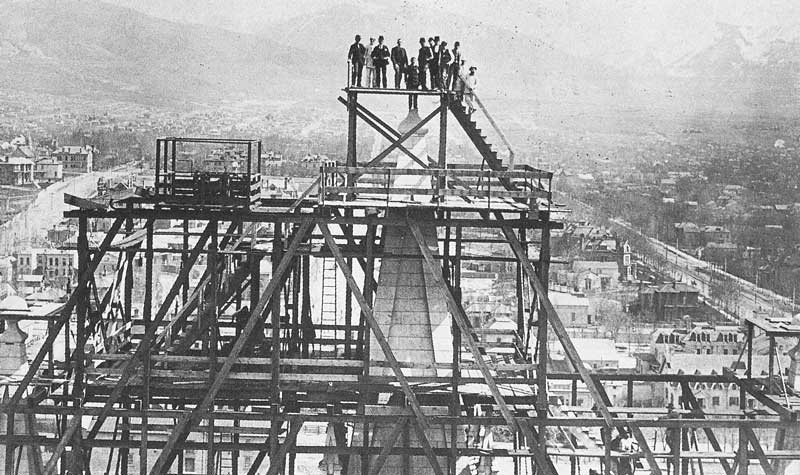 [p.160] 171. Situated on the opposite tower, Carter photographed temple workers standing on the pinnacle where the capstone was to be lowered into place. This picture was taken in April 1892, shortly before the capstone ceremony.