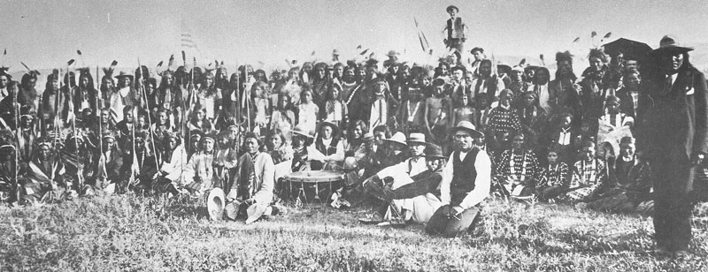 175. Native Americans in traditional dress are photographed by Carter at a July 4th or 24th celebration in 1881.