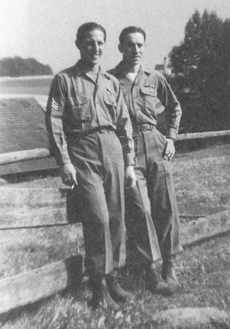 """""""My squad got right up next to the wall. We took a bayonet and put it on the end of a gun and poked a helmet up over that wall, and it got blown off immediately."""" Lincoln R. Whitaker (on left) with a friend in Germany."""
