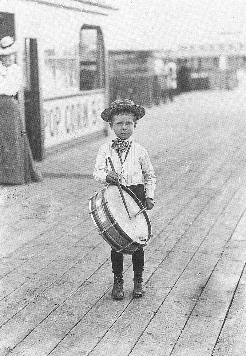 186. A young boy raps on his drum along the boardwalk at Saltair.