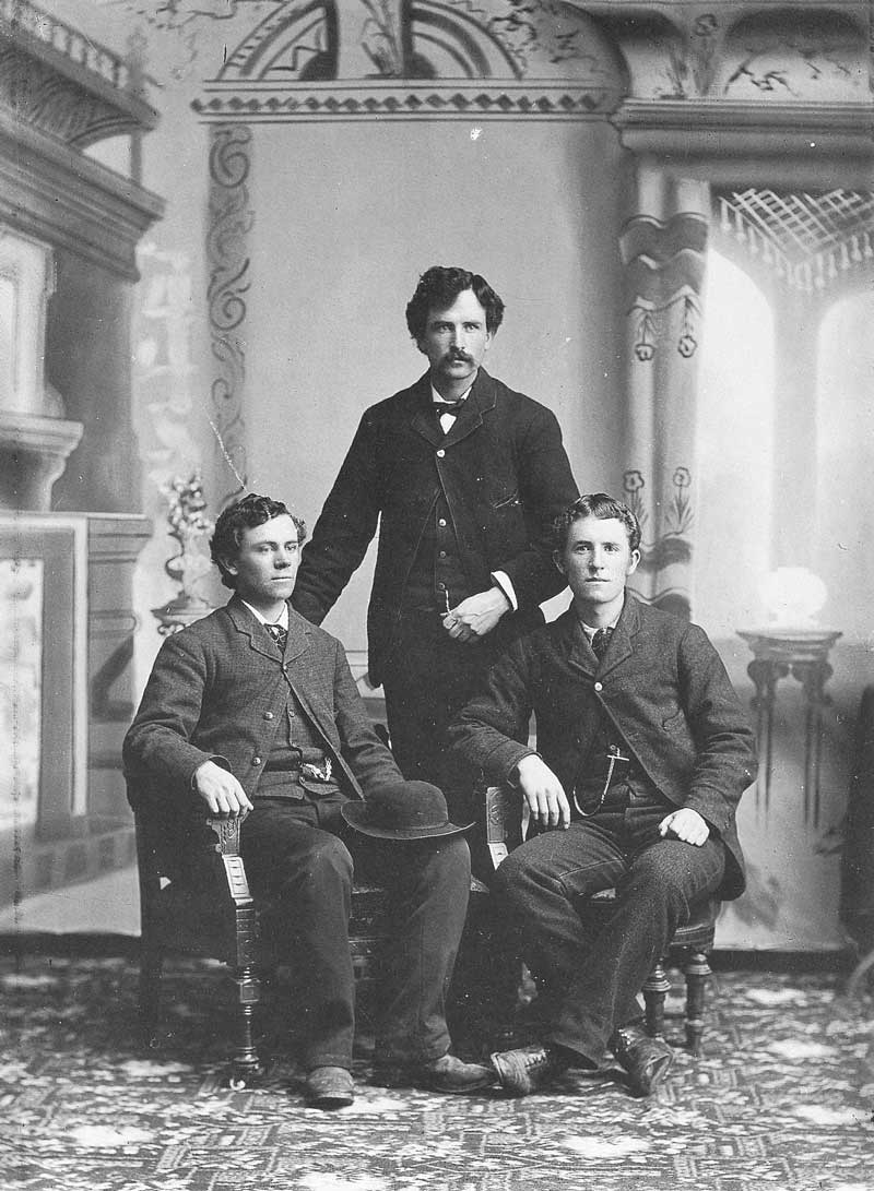 [p.180] 188. George E. Anderson (standing), J. Stanley Anderson (left), and Adam S. Anderson (right), at the time they were in business together in the early 1880s.