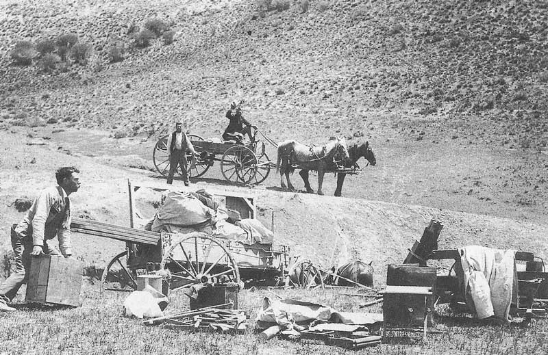 189. J. Stanley Anderson (left) prepares to load equipment for his brother's traveling tent gallery near Colton, Utah, in 1901. Anderson owned several portable galleries which his brothers or other operators moved from town to town.