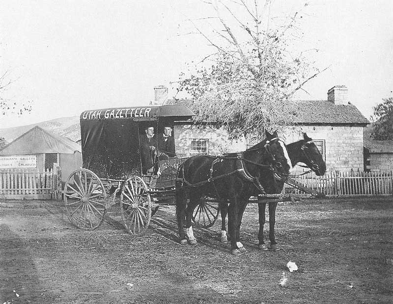 "190. A wagon loaded with Utah Gazeteers in 1884 somewhere in rural central Utah, the year Anderson advertised the ""finest portable galleries in the country."" In the background, behind the rear wheel of the wagon, is one of those galleries."