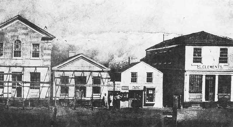 22. An early 1860s view of downtown business in Great Salt Lake City shows the wood and masonry construction of the buildings.