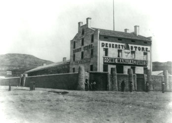 The Salt Lake Tithing Office and Deseret Store (also known as the Bishopsx Storehouse) on the corner of Main and South Temple streets (ca. 1858) where faithful Mormons donated one-tenth of their goods.