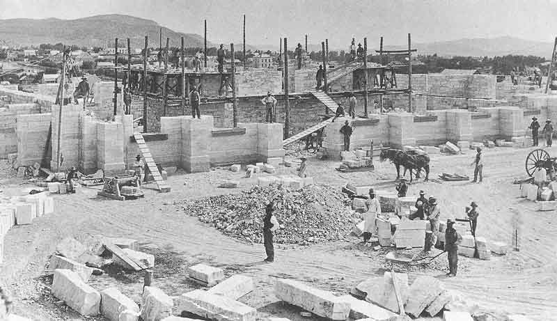 204. Stone cutters and masons work on the foundation of the Manti temple sometime after the cornerstones were laid in 1879. This photograph was taken by Anderson's mentor, C. R. Savage, before Anderson set up shop in Manti around 1882.