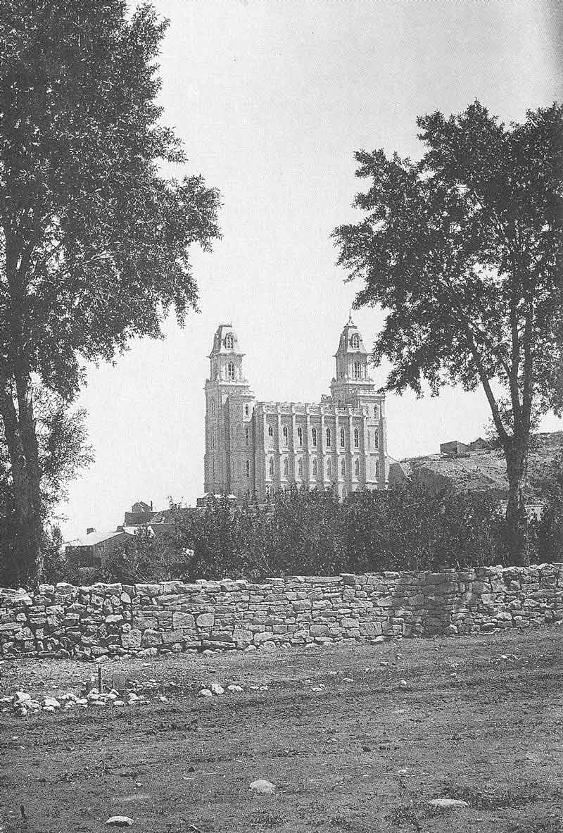205. The Manti temple is framed by trees and a textured stone wall in this 1888 view by Anderson, the year the temple was dedicated. He and Olive Lowry were the second couple married in the new temple.