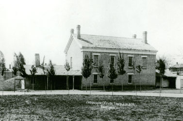 The Salt Lake Endowment House, located on Temple Square and separated from the Salt Lake Tabernacle by a high fence, was built of adobe in 1855 and used for the next thirty-four years to solemnize temple marriages prior to the completion of the Salt Lake Temple.