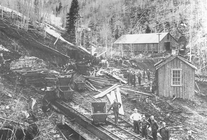 [p.201] 212. Debris is piled in front of the entrance to Winter Quarters Mine. On 2 or 3 May 1900, a violent explosion and fire killed nearly 200 coal miners. Survivors are working to clear the tunnel and remove bodies. Anderson made his way from Springville to Scofield to document the aftermath of the disaster.