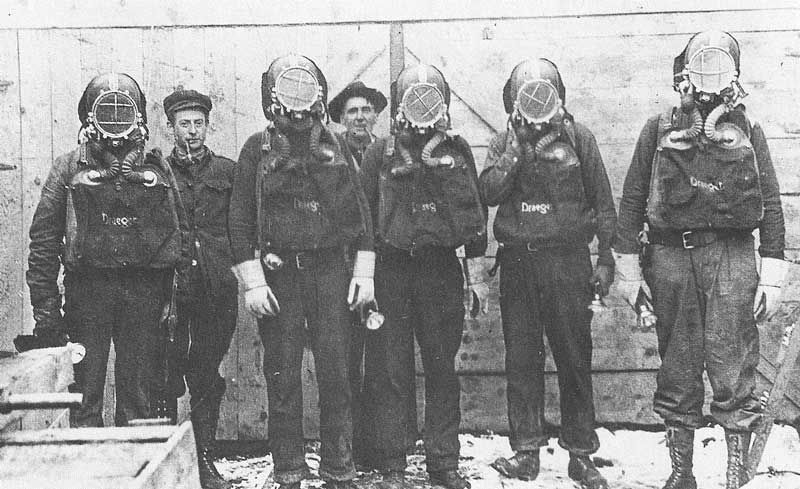 213. The mine rescue team wears special suits and oxygen masks for the hazardous descent into the contaminated mine.