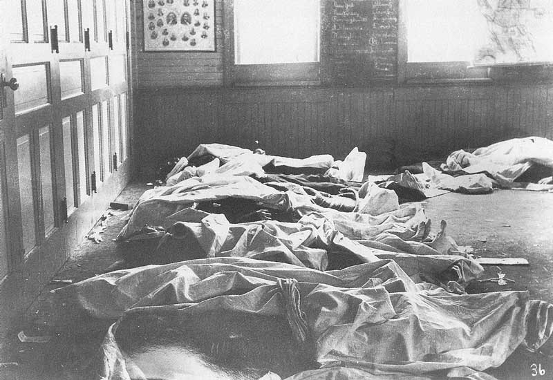 214. The dead miners' bodies are temporarily brought to the schoolhouse in Winter Quarters for identification.
