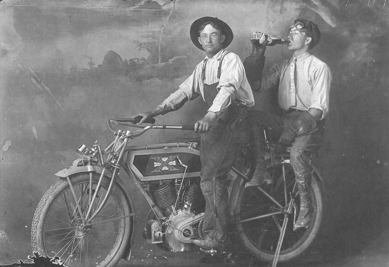 [p.207] 218. Joe Bagley, with a companion, on his new Excelsior Auto Cycle in front of the painted backdrop of the Huntington & Bagley Studio in Springville.
