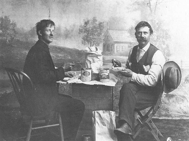 224. J. Stanley Anderson (right) enjoys lunch with an assistant while operating one of his brother's galleries in Utah prior to moving to Rexburg, Idaho, in 1902.