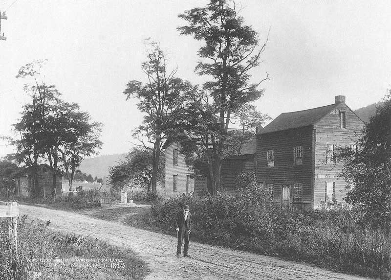 234. A man appears along a country lane in Harmony, Pennsylvania, in front of the building where Joseph Smith is said to have translated the bulk of the Book of Mormon.