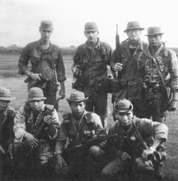 """""""That's where I got wounded. I suppose I'd call it a premonition that I ignored."""" Douglas T. Hall (back row, third from left) with part of his American-Montagnard Special Forces team."""