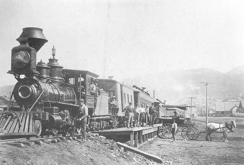 240. A Union Pacific train in Park City, Utah, loads baggage and passengers in 1891.
