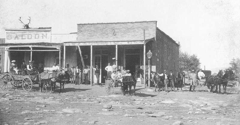 248. Residents of Silver Reef line up to have their picture taken in 1885. The saloon and general store served as hub of activity.