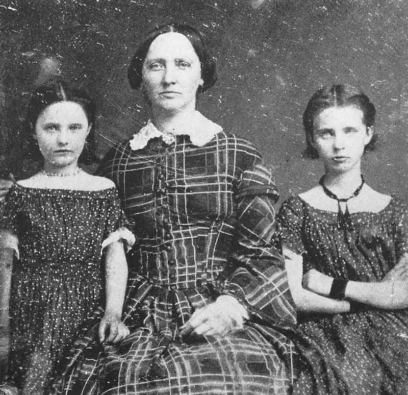 32. An unidentified pioneer mother with her two daughters is photographed in Marsena Cannon's gallery in the mid-1850s.