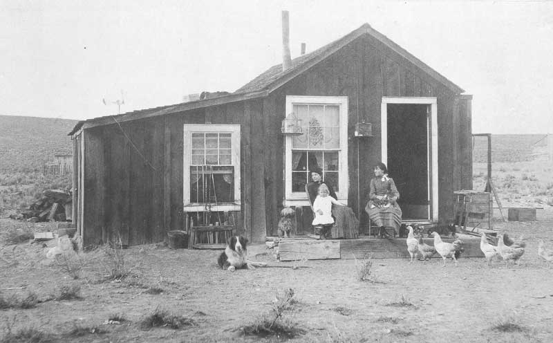 [p.241] 250. Two women on the doorstep of a wooden shack in Carlin, Nevada, in 1886.