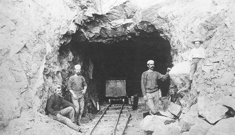253. Hard rock miners at the portal of a Nevada mine in 1886.