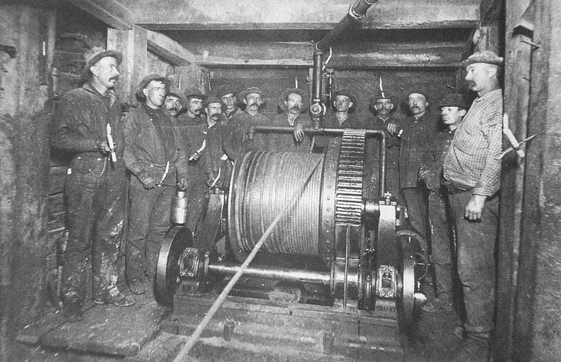 254. Miners stand around one of the cable hoists in Anchor Tunnels at the head of East Incline in Virginia City.