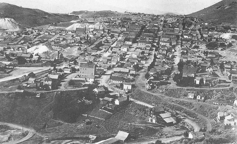 [p.248] 256, 257. Virginia City in its hey day (above as photographed by Crockwell in 1889 and (below) in 1991, when I retraced Crockwell's steps. Note the main highway still follows the same route but mining is at a standstill. Today Virginia City is a tourist stop with a rich boom-and-bust mining heritage.
