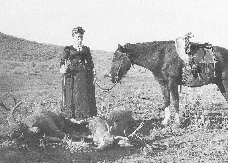 262. An Unidentified woman with her mule deer kill in the desert.