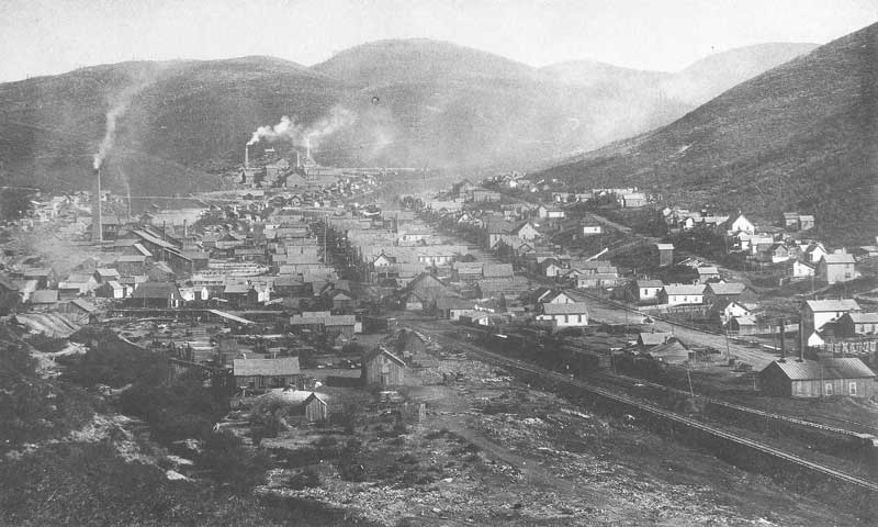 [p.253] 263. Smoke belches from the Ontario Mill in the distance in this 1891 view of Park City, Utah, looking south.