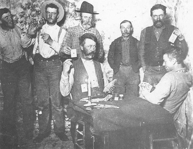 267. Miners play poker in this gag shot taken in the 1880s. This picture is undated, the location is not known, and it is uncertain whether Crockwell was the photographer, but it was found among other Crockwell mining pictures of Utah and Nevada.