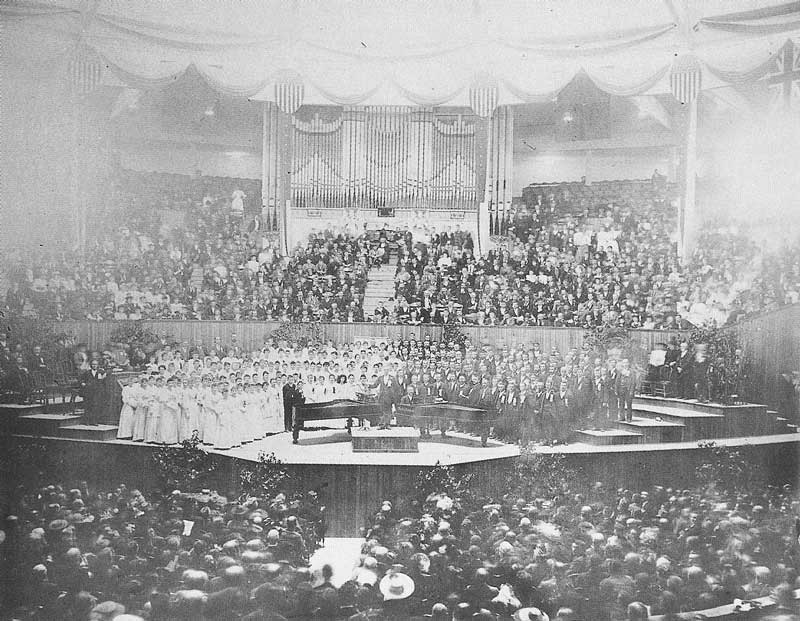 [p.260] 270. A faded bromide print shows all four choirs on the stage in Festival Hall in Chicago during the Eisteddfod International competition. The Mormon Tabernacle Choir, in their first tour outside of Utah, came away with the $1,000 second place ribbon.