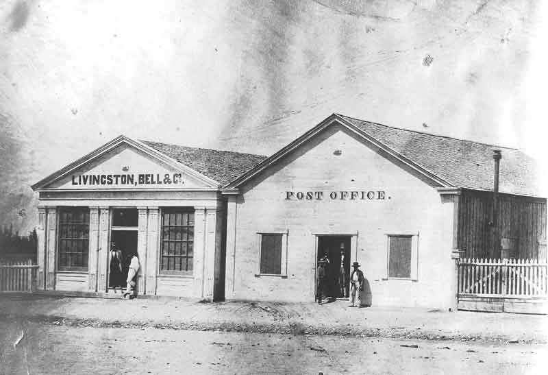 [p.26] 35. One of Salt Lake City's first post offices was located on Main Street, next to the mercantile firm of Livingston, Bell &amp; Company, one of the first commercial establishments in the frontier city. This picture, taken by Marsena Cannon around 1860, was one of the first of Main Street and the business hub of Great Salt Lake City.
