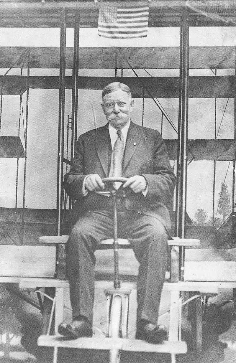 "275. Crockwell in a photo gimmick booth at an amusement park. The picture is mounted on a card that reads, ""Souvenir of Coney Island."" This is the last known picture of Crockwell, taken not long before he died in Alameda, California, in 1940."