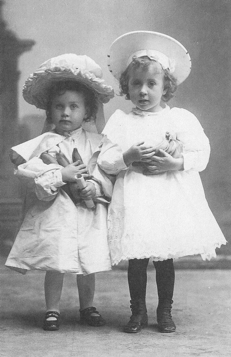 280. Two young girls, their arms loaded with bananas, in Johnson's gallery in the 1890s. Photographing children was Johnson's specialty.