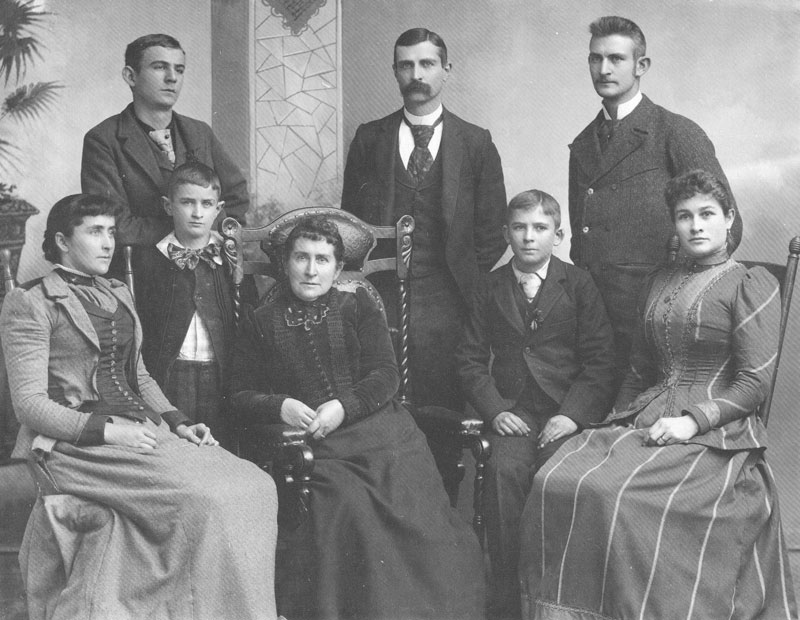 [p.275] 281. Eliza Johnson (seated center) surrounded by her family on 19 December 1892, when her son (standing center) was operating the Sainsbury & Johnson Gallery. Sitting left to right, are Emily Maude, Eliza, Seth Guernsey, and Rosemary. Standing are Benjamin Franklin, Rufus David, Charles Ellis, and George William.
