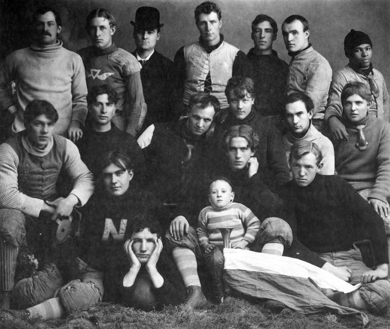 [p.291] 297. Members of a football team in padded uniforms sometime around 1890. Note the cloth pads and crude nose guards.