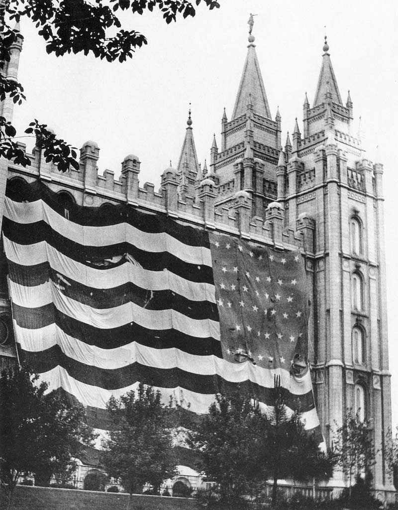 "[p.293] 298. The so-called ""Utah Flag"" with a new star for Utah was hung first in the tabernacle after Utah achieved statehood in 1896, then draped for a time from the side of the temple."