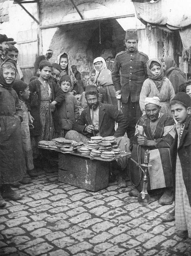 [p.304] 308. A man sells pita bread in the marketplace.