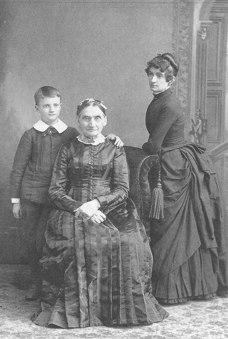 [p.323] 318. Young Harry Shipler, age nine, with his grandmother, Margaret Wharton Shipler, and mother, Lizzy Taylor Shipler, in his father's gallery in McKeesport, Pennsylvania, in 1887.