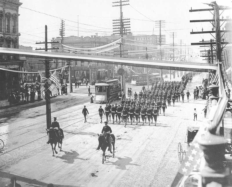 [p.324] 319. Soldiers march down Salt Lake City's Main Street on 30 May 1903 in celebration of Memorial Day.