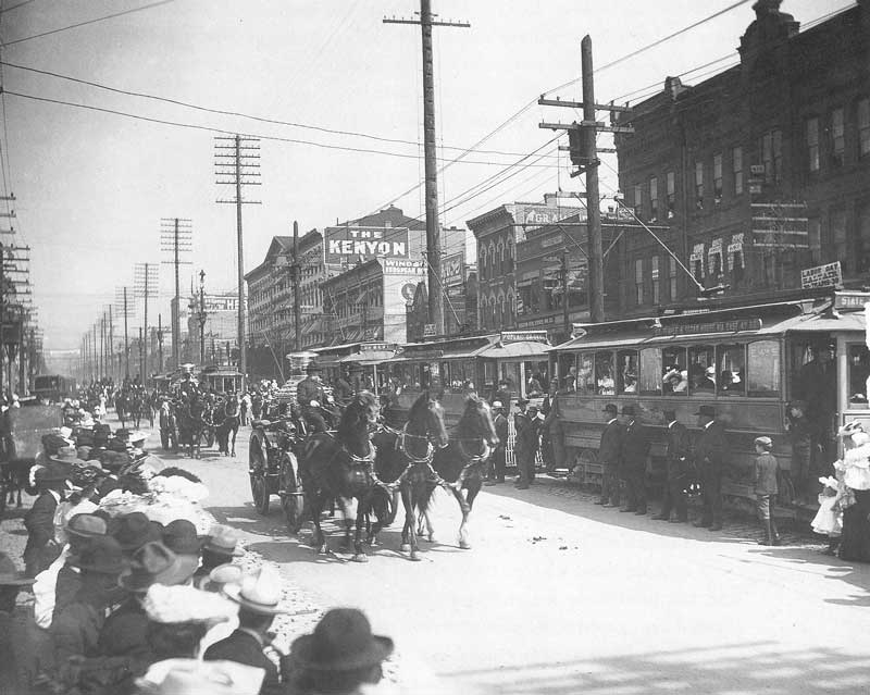 [p.325] 320. Salt Lake City's steam-powered fire engines parade down Main Street on Labor Day, 3 September 1906. On the right some of the city's street cars line up to accept passengers.