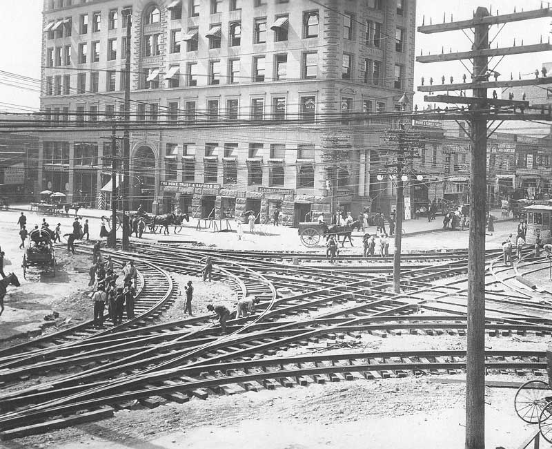 [p.327] 321. Workmen install streetcar tracks at the intersection of Main and First South. In the background is the old McCornick Building. Edward H. Harriman, who had acquired Union Pacific shortly before the turn of the century, built the streetcar system in Salt Lake City, acclaimed to be among the most modern in the world.
