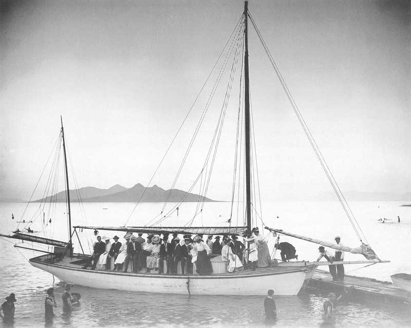 [p.329] 323. Men and women board a sailing ship for a pleasure cruise on the Great Salt Lake on Pioneer Day, 24 July 1906.