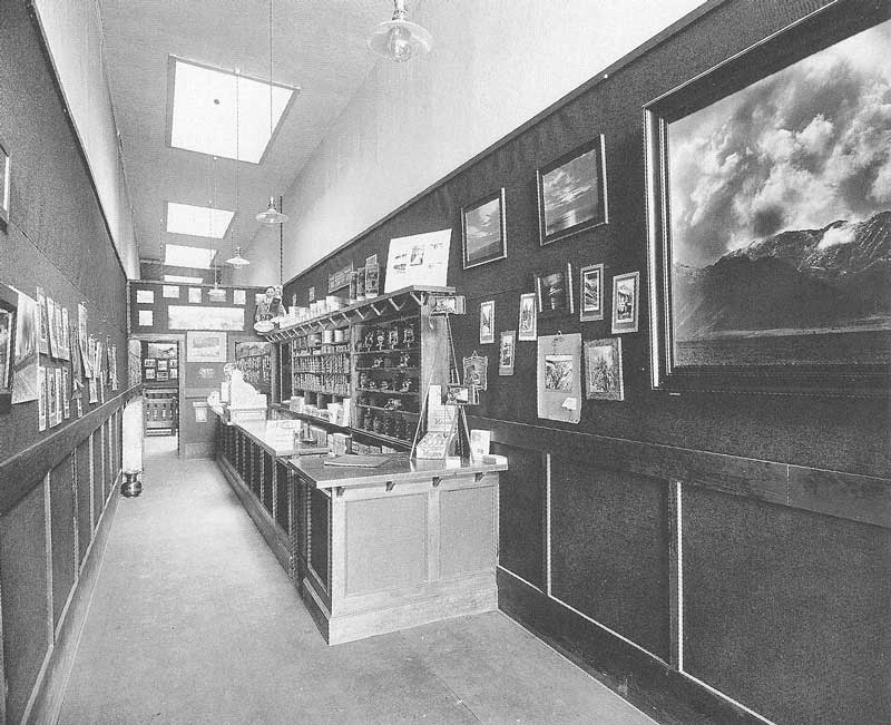 "325. Shipler's photo store on Christmas day in 1912. In the backroom is a lounge where the so-called ""Liar's Club"" gathered to swap fishing stories."